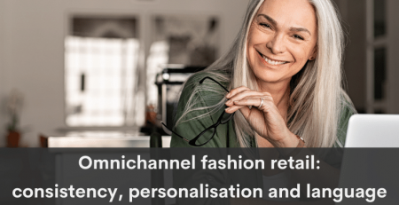 Omnichannel fashion retail translation: Middle-aged womanis sitting at her desk with an open lap-top with her glasses in her hand. She is smilig at us. Caption: Omnichannel fashion retail: consistency, personalisation and language - LocAtHeart translation agency